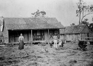 StateLibQld_1_51444_Family_in_front_of_their_farm_house,_ca._1900