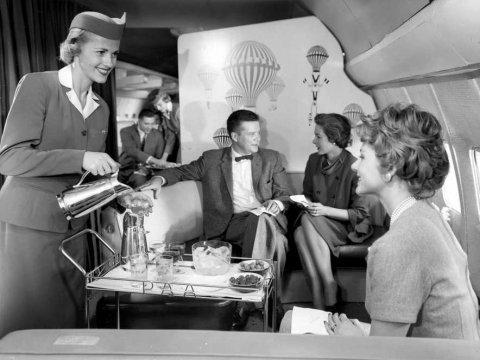 a-flight-attendant-serves-a-pan-am-passenger-on-a-boeing-707-121